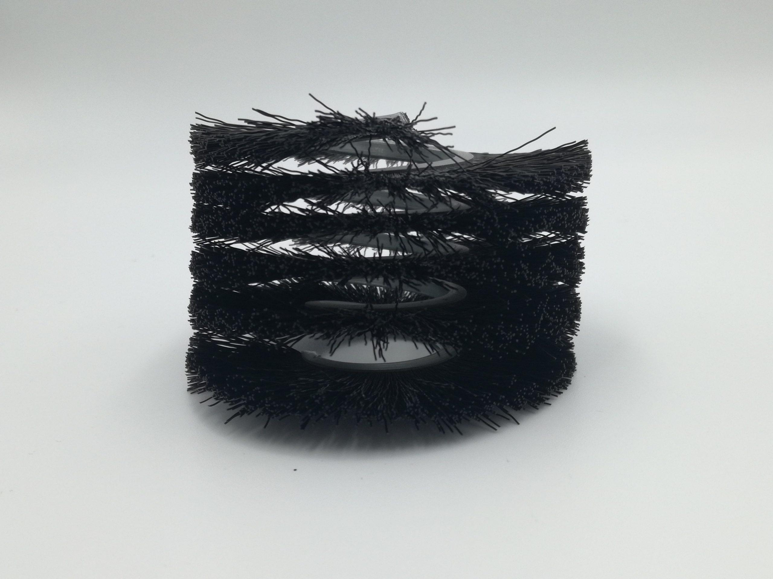 cepillo strip en espiral metálica fibra sintética hacia el exterior